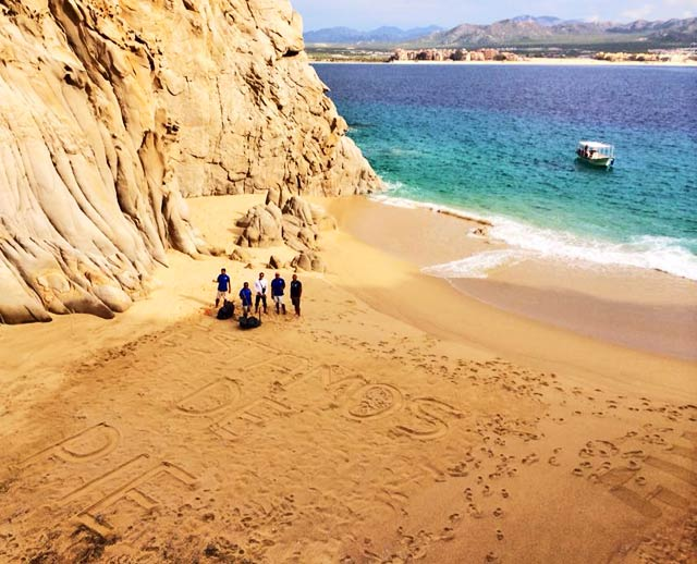 """The Cabo Expeditions Team providing post-storm beach cleanup. """"Estamos de Pie"""" translates to """"We are Standing!"""""""