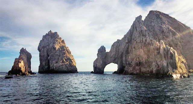 View of El Arco from the Rissalena Catamaran sunset cruise
