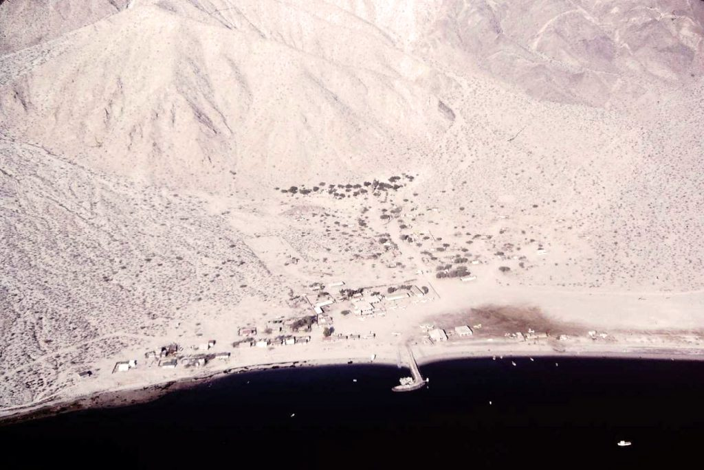 Bahia de los Angeles - Baja California, Mexico in 1972. The runway parallels the beach above the buildings to the right of the pier.